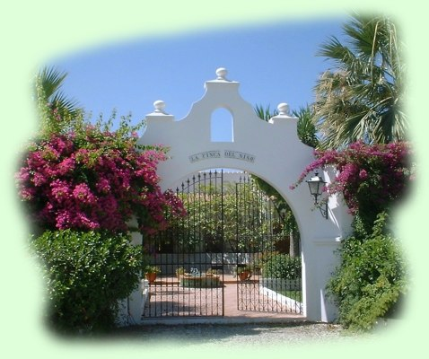 Gate of Finca del Niño in the sun light of southern Spain