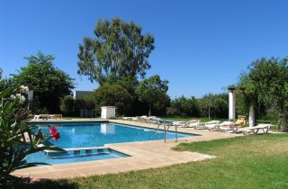 Holiday activity: swimming pool of finca with relaxing area